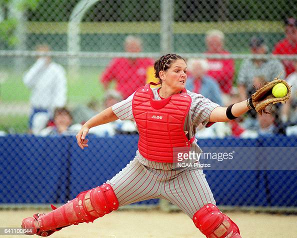 Catcher Annie Van Wetzinga of Central College snags a throw to home a bit too late as Muskingum College's Chantelle Andrews scores during the...