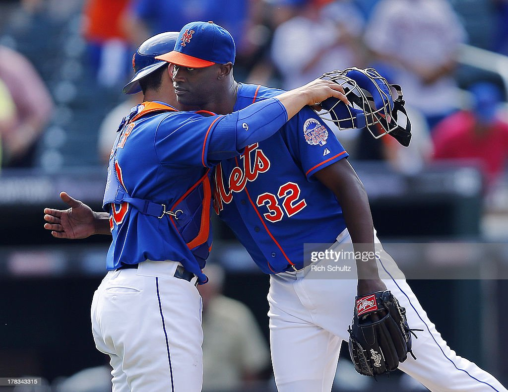 Catcher Anthony Recker #20 hugs closer <a gi-track='captionPersonalityLinkClicked' href=/galleries/search?phrase=LaTroy+Hawkins&family=editorial&specificpeople=204722 ng-click='$event.stopPropagation()'>LaTroy Hawkins</a> #32 of the New York Mets after defeating the Philadelphia Phillies 11-3 on August 29, 2013 at Citi Field in the Flushing neighborhood of the Queens borough of New York City.