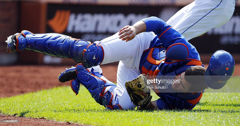 Catcher Anthony Recker #20 of the New York Mets makes a catch on a foul pop hit by Roger Bernadina #3 of the Philadelphia Phillies during the sixth inning on August 29, 2013 at Citi Field in the Flushing neighborhood of the Queens borough of New York City.