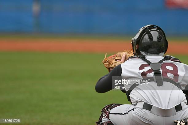 Catcher at a baseball game in position to catch