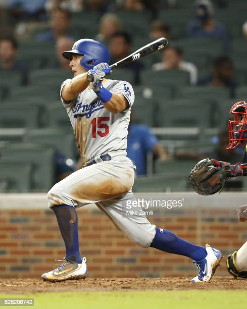 Catcher Austin Barnes of the Los Angeles Dodgers hits an RBI double in the ninth inning during the game against the Atlanta Braves at SunTrust Park...