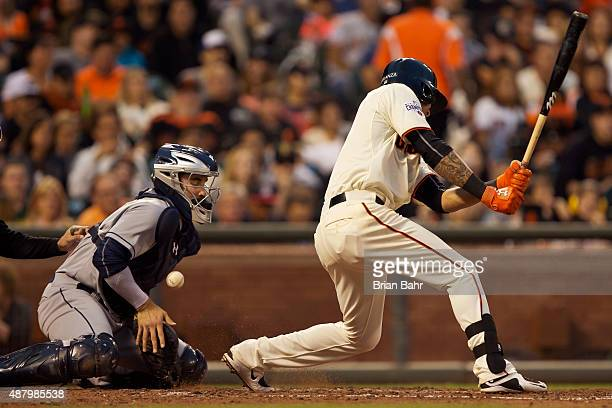 Catcher Austin Hedges of the San Dieigo Padres corrals a pitch in the dirt against batter Ehire Adrianza of the San Francisco Giants in the fourth...