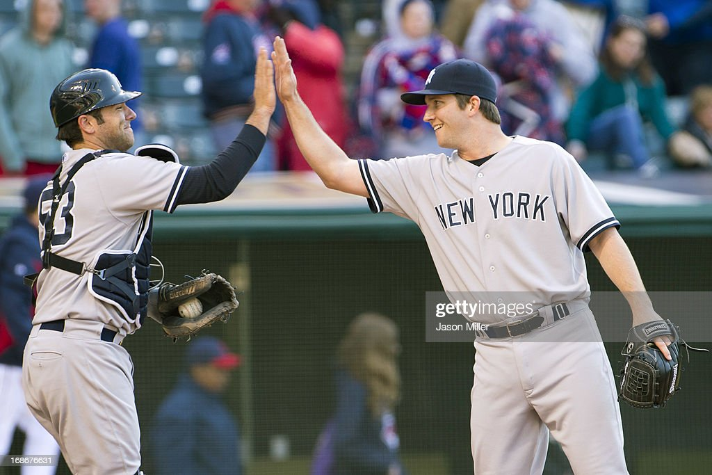 Catcher Austin Romine #53 celebrates with closing pitcher Adam Warren #43 of the New York Yankees after the Yankees defeated the Cleveland Indians during the second game of a doubleheader at Progressive Field on May 13, 2013 in Cleveland, Ohio. The Yankees defeated the Indians 7-0.