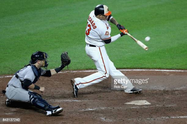 Catcher Austin Romine of the New York Yankees looks on as Manny Machado of the Baltimore Orioles hits a walk off two RBI home run to give the Orioles...