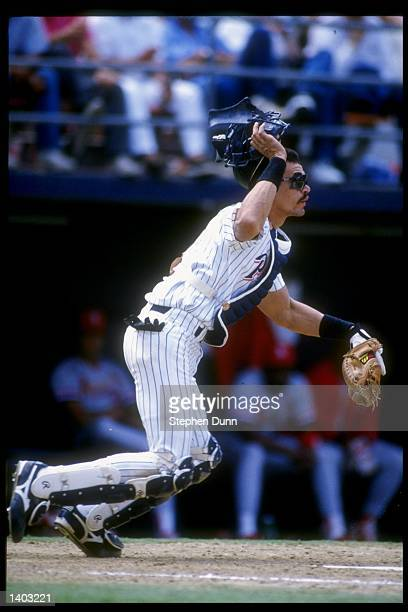 Catcher Benito Santiago of the San Diego Padres runs to field a ball during a game against the St Louis Cardinals at Jack Murphy Stadium in San Diego...