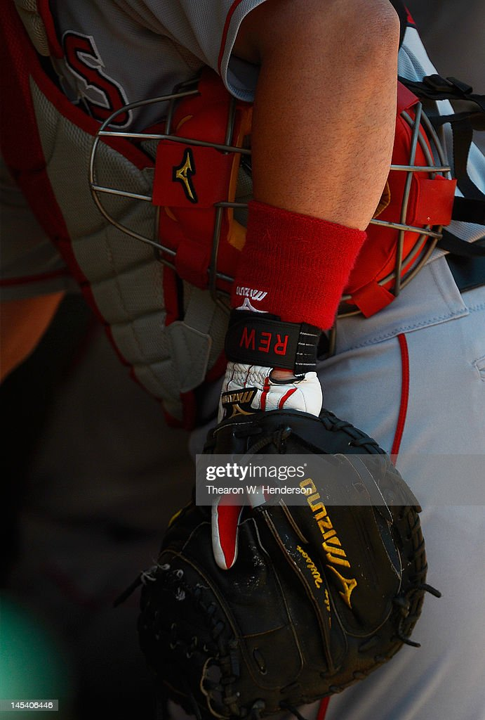 Catcher Bobby Wilson #46 of the Los Angeles Angels of Anaheim holds on to his mask and catchers glove standing in the dugout against the Oakland Athletics at O.co Coliseum on May 23, 2012 in Oakland, California. The Angels won the game in eleven inning 3-1.