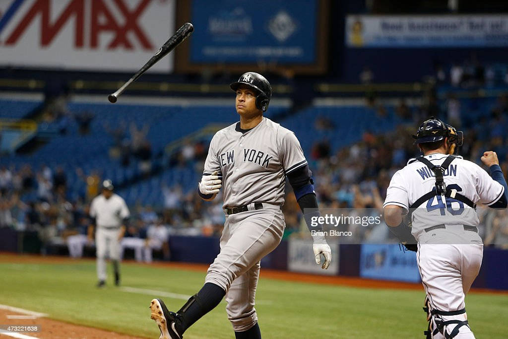 Catcher Bobby Wilson #46 of the Tampa Bay Rays and Alex Rodriguez #13 of the New York Yankees both react after Rodriguez struck out swinging to end a game on May 13, 2015 at Tropicana Field in St. Petersburg, Florida.