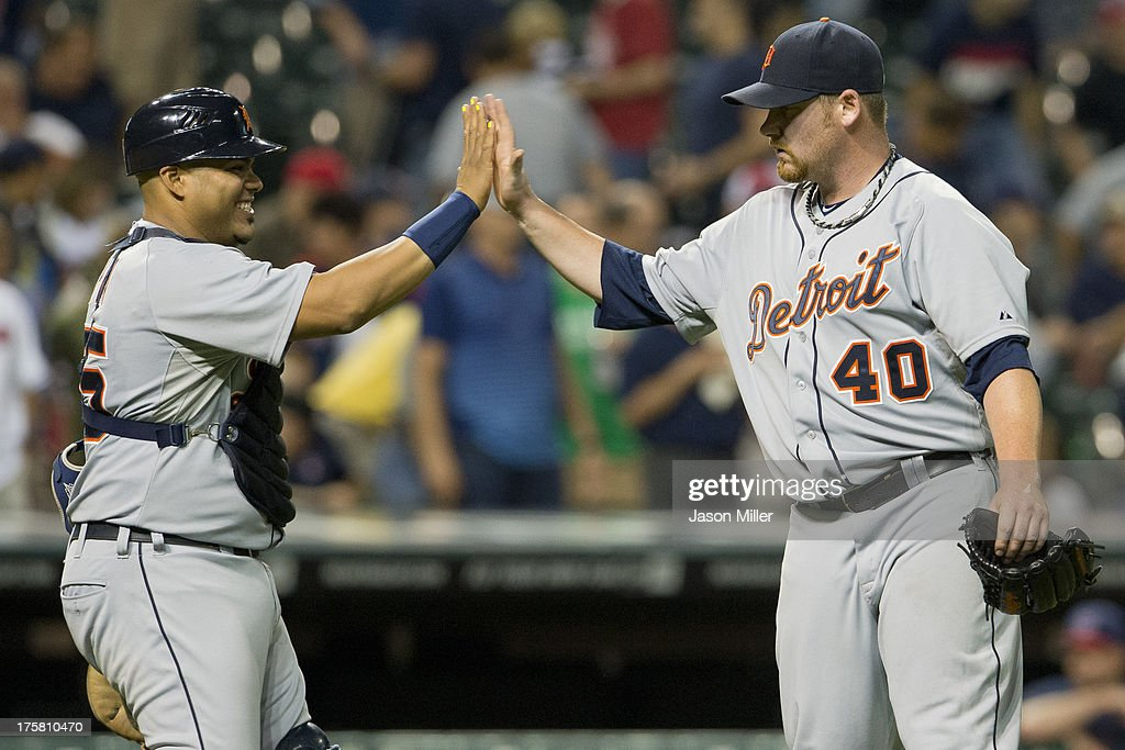Catcher <a gi-track='captionPersonalityLinkClicked' href=/galleries/search?phrase=Brayan+Pena&family=editorial&specificpeople=545678 ng-click='$event.stopPropagation()'>Brayan Pena</a> #55 celebrates with closing pitcher Phil Coke #40 of the Detroit Tigers after the Tigers defeated the Cleveland Indians at Progressive Field on August 8, 2013 in Cleveland, Ohio. The Tigers defeated the Indians 10-3.
