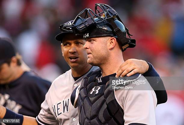 Catcher Brian McCann and designated hitter Alex Rodgriguez of the New York Yankees celebrate after the game with the Los Angeles Angels of Anaheim at...