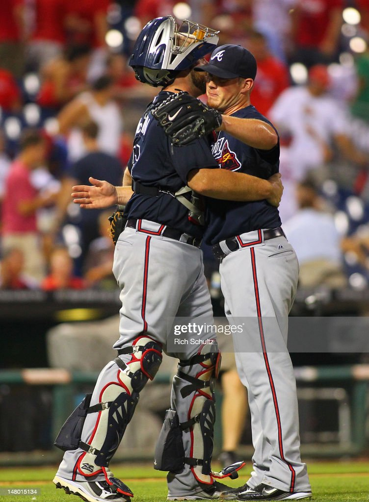 Catcher <a gi-track='captionPersonalityLinkClicked' href=/galleries/search?phrase=Brian+McCann+-+Baseball+Player&family=editorial&specificpeople=593065 ng-click='$event.stopPropagation()'>Brian McCann</a> #16 of the Atlanta Braves hugs closer <a gi-track='captionPersonalityLinkClicked' href=/galleries/search?phrase=Craig+Kimbrel&family=editorial&specificpeople=6795784 ng-click='$event.stopPropagation()'>Craig Kimbrel</a> #46 after the final out against the Philadelphia Phillies during a MLB baseball game on July 7, 2012 at Citizens Bank Park in Philadelphia, Pennsylvania. The Braves defeated the Phillies 6-3.