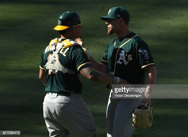 Catcher Bruce Maxwell and closing pitcher Blake Treinen of the Oakland Athletics congratulate one another after the MLB game against the Los Angeles...