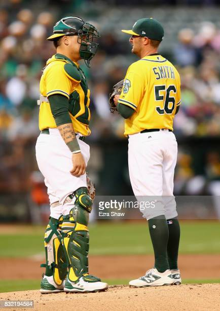 Catcher Bruce Maxwell talks to pitcher Chris Smith of the Oakland Athletics in the first inning against the Kansas City Royals at Oakland Alameda...