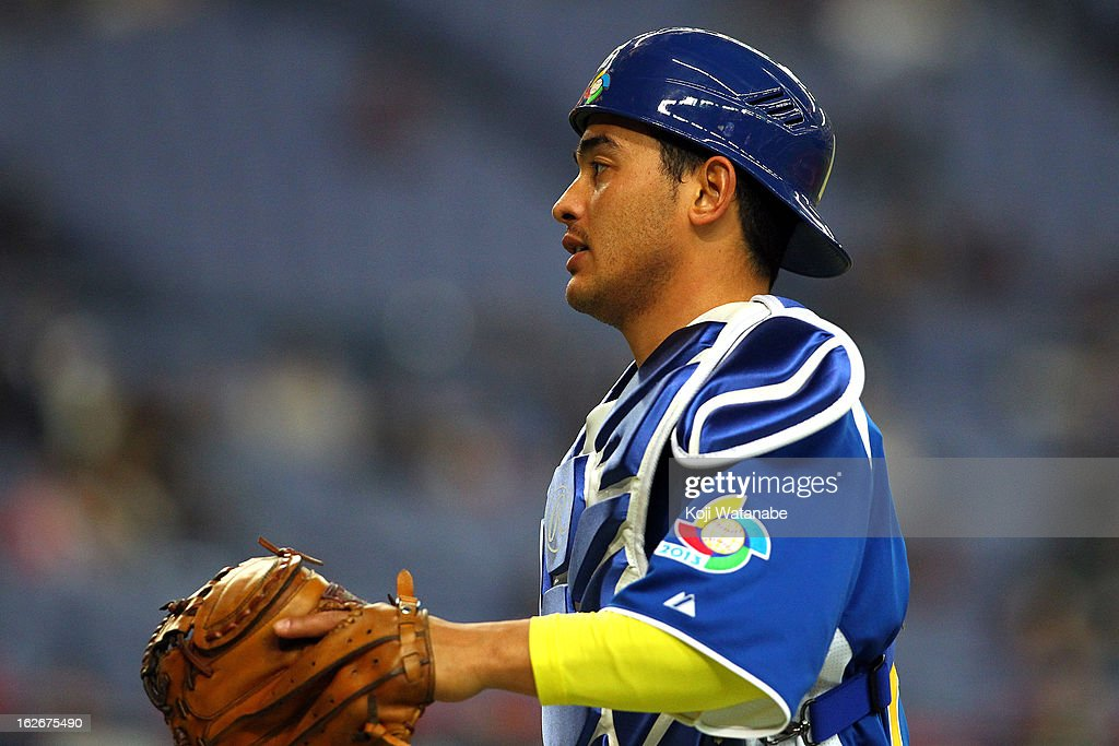 Catcher Bruno Hirata #26 of Brazil in action during the friendly game between Orix Buffaloes and Brazil at Kyocera Dome Osaka on February 26, 2013 in Osaka, Japan.