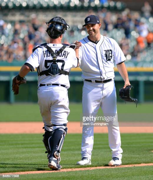Catcher Bryan Holaday of the Detroit Tigers congratulates pitcher Matthew Boyd after Boyd pitched a complete game onehit shutout against the Chicago...