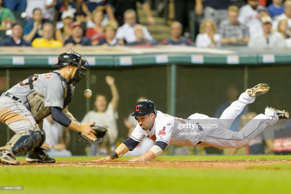 Catcher <a gi-track='captionPersonalityLinkClicked' href=/galleries/search?phrase=Bryan+Holaday&family=editorial&specificpeople=7511226 ng-click='$event.stopPropagation()'>Bryan Holaday</a> #50 of the Detroit Tigers misses the catch as <a gi-track='captionPersonalityLinkClicked' href=/galleries/search?phrase=Jason+Kipnis&family=editorial&specificpeople=5330784 ng-click='$event.stopPropagation()'>Jason Kipnis</a> #22 is safe at home on a hit by Yan Gomes #10 of the Cleveland Indians during the fourth inning at Progressive Field on September 3, 2014 in Cleveland, Ohio.