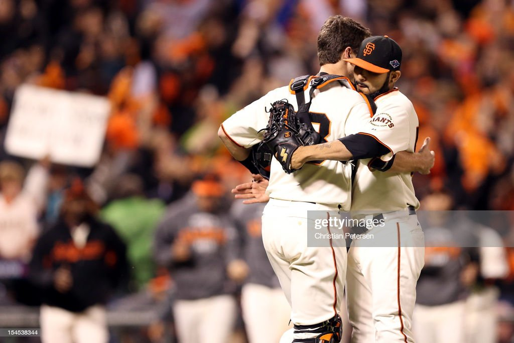 Catcher Buster Posey #35 and Sergio Romo #54 of the San Francisco Giants reacts after recording the last out as the Giants defeat the St. Louis Cardinals 6-1 in Game Six of the National League Championship Series at AT&T Park on October 21, 2012 in San Francisco, California.
