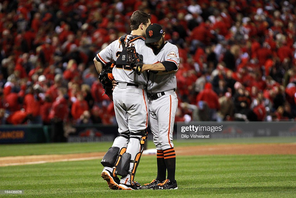 Catcher <a gi-track='captionPersonalityLinkClicked' href=/galleries/search?phrase=Buster+Posey&family=editorial&specificpeople=4896435 ng-click='$event.stopPropagation()'>Buster Posey</a> #28 and <a gi-track='captionPersonalityLinkClicked' href=/galleries/search?phrase=Sergio+Romo&family=editorial&specificpeople=5433590 ng-click='$event.stopPropagation()'>Sergio Romo</a> #54 of the San Francisco Giants celebrate the Giants 5-0 victory in Game Five of the National League Championship Series at Busch Stadium on October 19, 2012 in St Louis, Missouri.