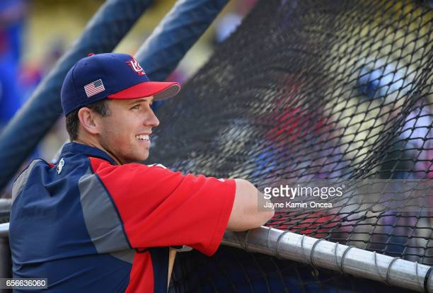 Catcher Buster Posey of team United States smiles during batting practice before taking on team Puerto Rico during Game 3 of the Championship Round...