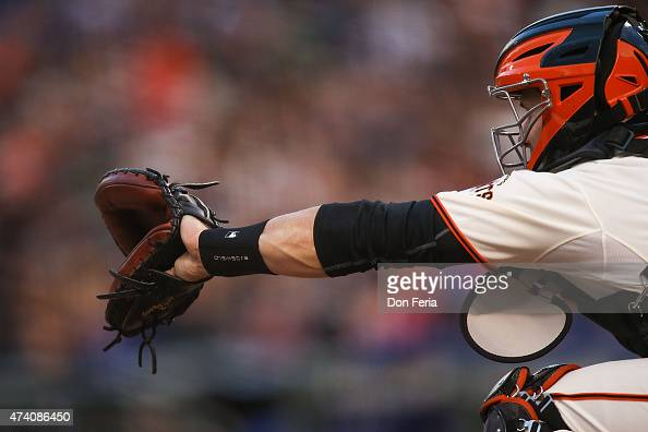 Catcher Buster Posey of the San Francisco Giants rests his Rawlings glove during play between the San Francisco Giants and the visiting Los Angeles...