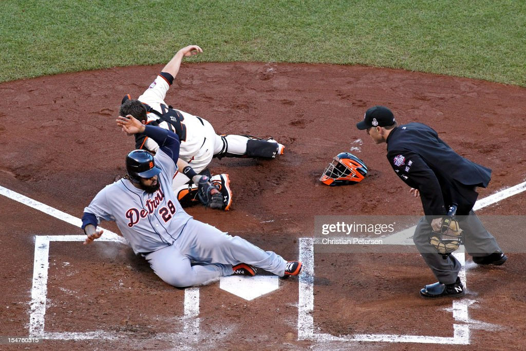 Catcher Buster Posey #28 of the San Francisco Giants tags out Prince Fielder #28 of the Detroit Tigers at home plate in the second inning during Game Two of the Major League Baseball World Series at AT&T Park on October 25, 2012 in San Francisco, California.