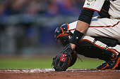 Catcher Buster Posey San Francisco Giants rests his Rawlings glove during play between the San Francisco Giants and the visiting Los Angeles Dodgers...