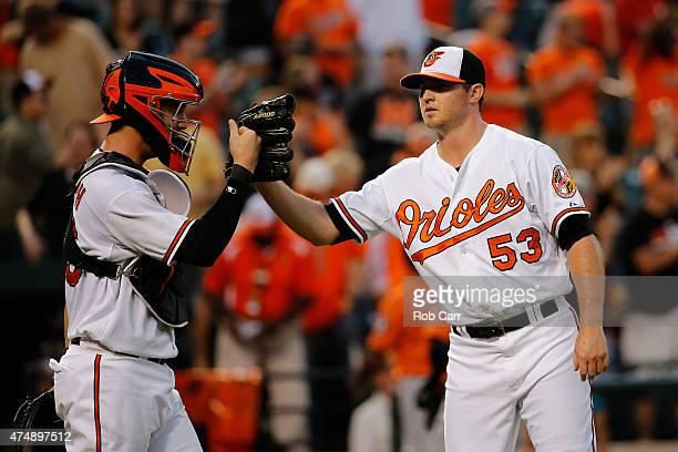 Catcher Caleb Joseph of the Baltimore Orioles and pitcher Zach Britton celebrate following the Orioles 54 win over the Houston Astros at Oriole Park...