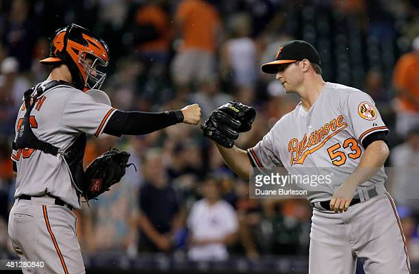 Catcher Caleb Joseph of the Baltimore Orioles celebrates a 30 win over the Detroit Tigers with Zach Britton of the Baltimore Orioles at Comerica Park...