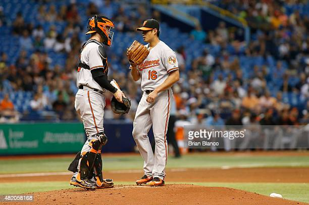 Catcher Caleb Joseph of the Baltimore Orioles comes out to speak with pitcher WeiYin Chen of the Baltimore Orioles after Chen gave up a double to...