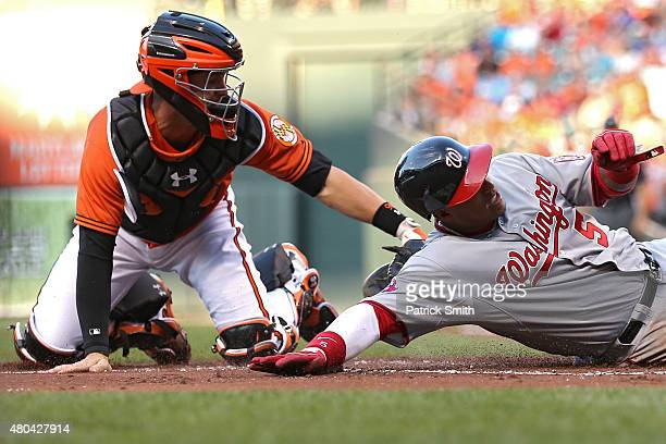 Catcher Caleb Joseph of the Baltimore Orioles tags out Yunel Escobar of the Washington Nationals at home plate in the first inning at Oriole Park at...