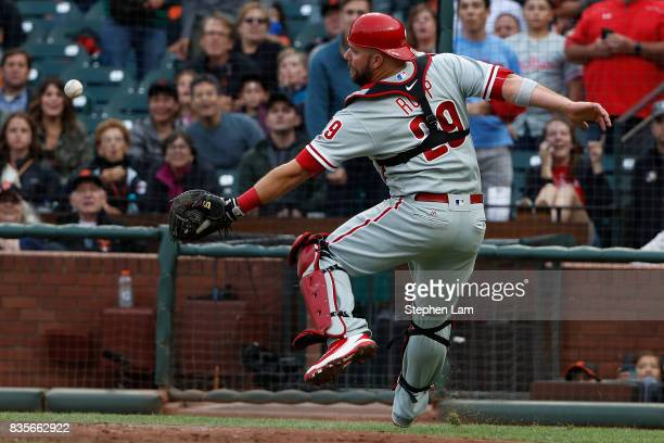 Catcher Cameron Rupp of the Philadelphia Phillies couldn't catch a foul ball during the second inning against the San Francisco Giants at ATT Park on...