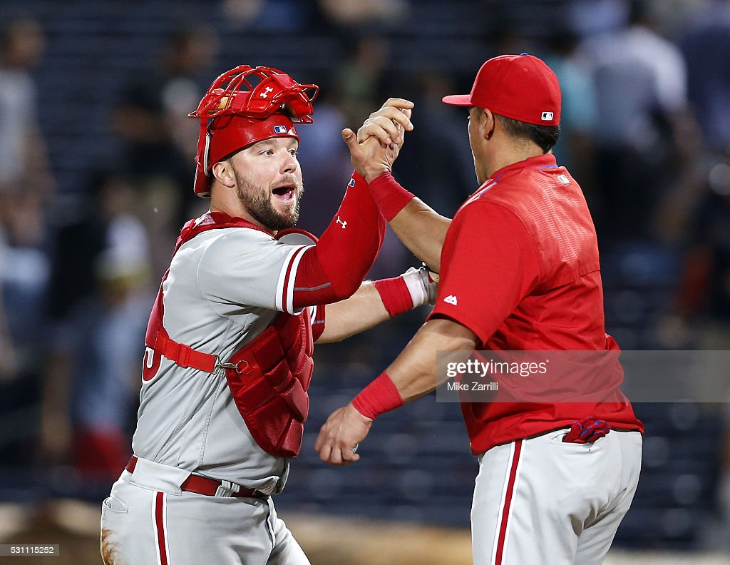 Catcher Cameron Rupp #29 of the Philadelphia Phillies high-fives teammate <a gi-track='captionPersonalityLinkClicked' href=/galleries/search?phrase=Carlos+Ruiz+-+Baseball+Player&family=editorial&specificpeople=216605 ng-click='$event.stopPropagation()'>Carlos Ruiz</a> #51 after the game against the Atlanta Braves at Turner Field on May 12, 2016 in Atlanta, Georgia.