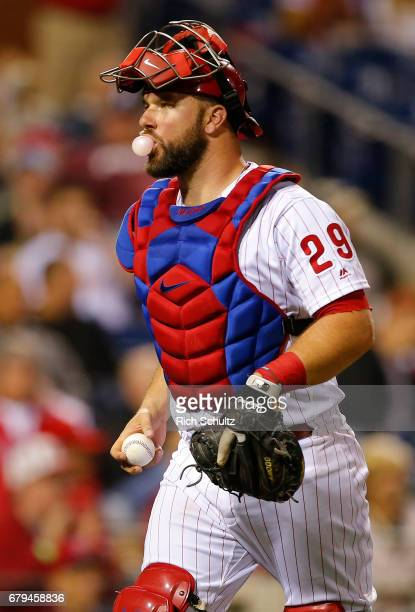 Catcher Cameron Rupp of the Philadelphia Phillies runs off the field blowing a bubble in the sixth inning against the Washington Nationals during a...