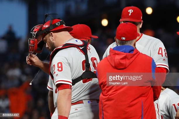 Catcher Cameron Rupp of the Philadelphia Phillies spits during a visit to the pitcher's mound during the fourth inning against the San Francisco...