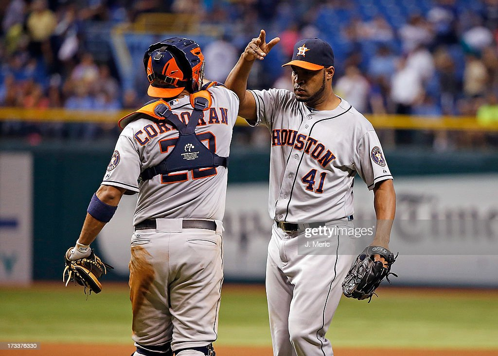 Catcher <a gi-track='captionPersonalityLinkClicked' href=/galleries/search?phrase=Carlos+Corporan&family=editorial&specificpeople=5716887 ng-click='$event.stopPropagation()'>Carlos Corporan</a> #22 of the Houston Astros congratulates pitcher <a gi-track='captionPersonalityLinkClicked' href=/galleries/search?phrase=Jose+Veras&family=editorial&specificpeople=846188 ng-click='$event.stopPropagation()'>Jose Veras</a> #41 after his save over the Tampa Bay Rays at Tropicana Field on July 12, 2013 in St. Petersburg, Florida.