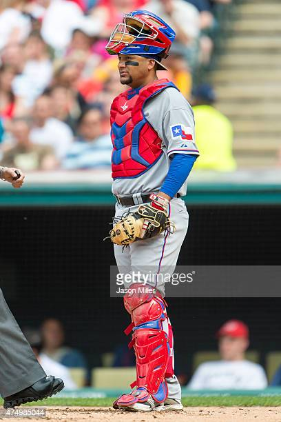 Catcher Carlos Corporan of the Texas Rangers pauses between plays during the first inning against the Cleveland Indians at Progressive Field on May...