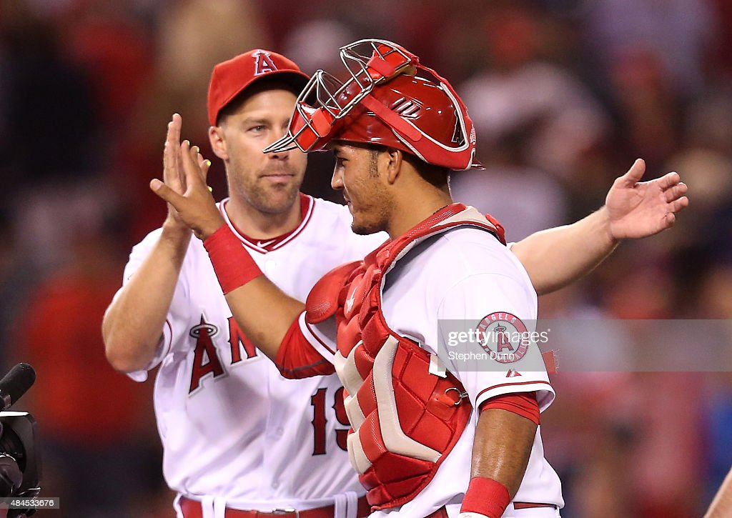 Catcher Carlos Perez #58 of the Los Angeles Angels of Anaheim celebrates with <a gi-track='captionPersonalityLinkClicked' href=/galleries/search?phrase=David+Murphy+-+Baseball+Player&family=editorial&specificpeople=4604222 ng-click='$event.stopPropagation()'>David Murphy</a> #19 after the game with the Chicago White Sox at Angel Stadium of Anaheim on August 19, 2015 in Anaheim, California. The Angels won 1-0.
