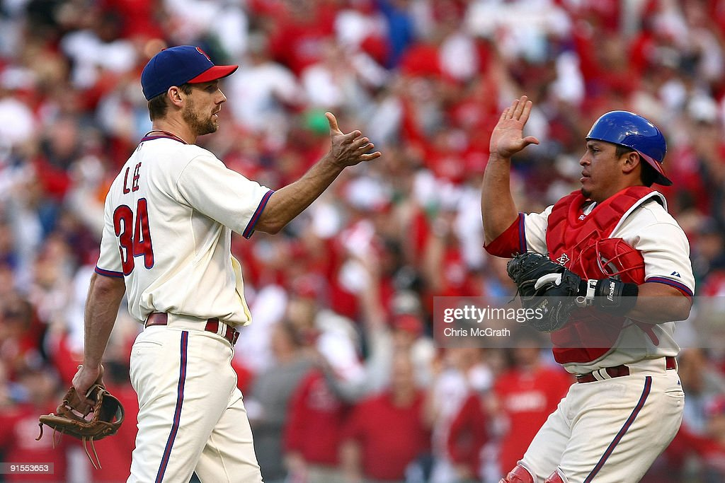 Catcher <a gi-track='captionPersonalityLinkClicked' href=/galleries/search?phrase=Carlos+Ruiz+-+Baseball+Player&family=editorial&specificpeople=216605 ng-click='$event.stopPropagation()'>Carlos Ruiz</a> (R) #51 and <a gi-track='captionPersonalityLinkClicked' href=/galleries/search?phrase=Cliff+Lee&family=editorial&specificpeople=218092 ng-click='$event.stopPropagation()'>Cliff Lee</a> #34 of the Philadelphia Phillies celebrate their 5-1 win against the Colorado Rockies in Game One of the NLDS during the 2009 MLB Playoffs at Citizens Bank Park on October 7, 2009 in Philadelphia, Pennsylvania.