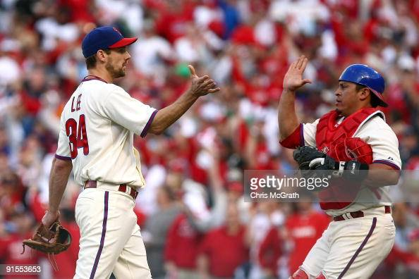 Catcher Carlos Ruiz and Cliff Lee of the Philadelphia Phillies celebrate their 51 win against the Colorado Rockies in Game One of the NLDS during the...