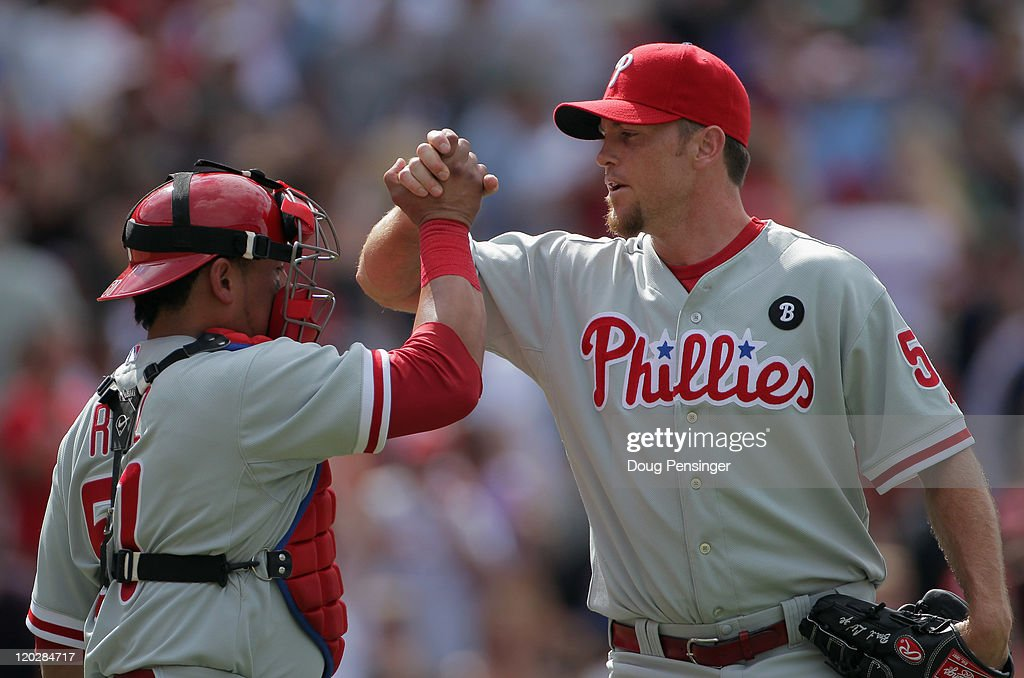Catcher Carlos Ruiz and closer Brad Lidge of the Philadelphia Phillies celebrate their victory over the Colorado Rockies at Coors Field on August 3...