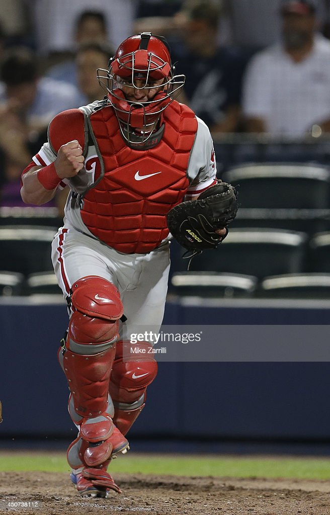 Catcher Carlos Ruiz #51 of the Philadelphia Phillies celebrates after getting the last out of the 10th inning to keep the game going against the Atlanta Braves at Turner Field on June 16, 2014 in Atlanta, Georgia.