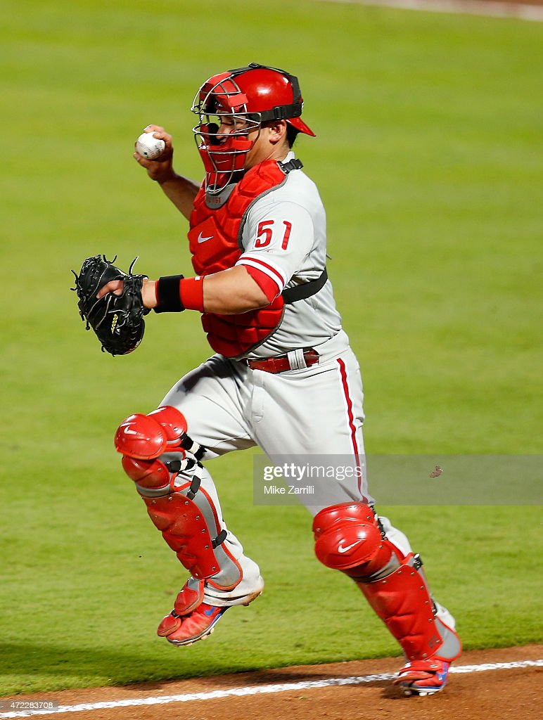 Catcher Carlos Ruiz of the Philadelphia Phillies chases a runner back to third base during the game against the Atlanta Braves at Turner Field on May...