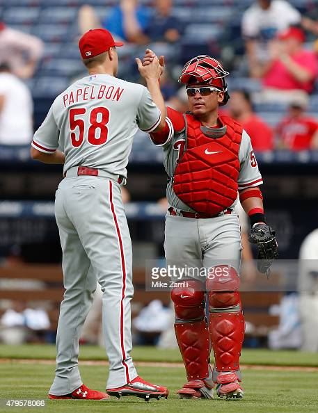 Catcher Carlos Ruiz of the Philadelphia Phillies congratulates closer Jonathan Papelbon after the game against the Atlanta Braves at Turner Field on...