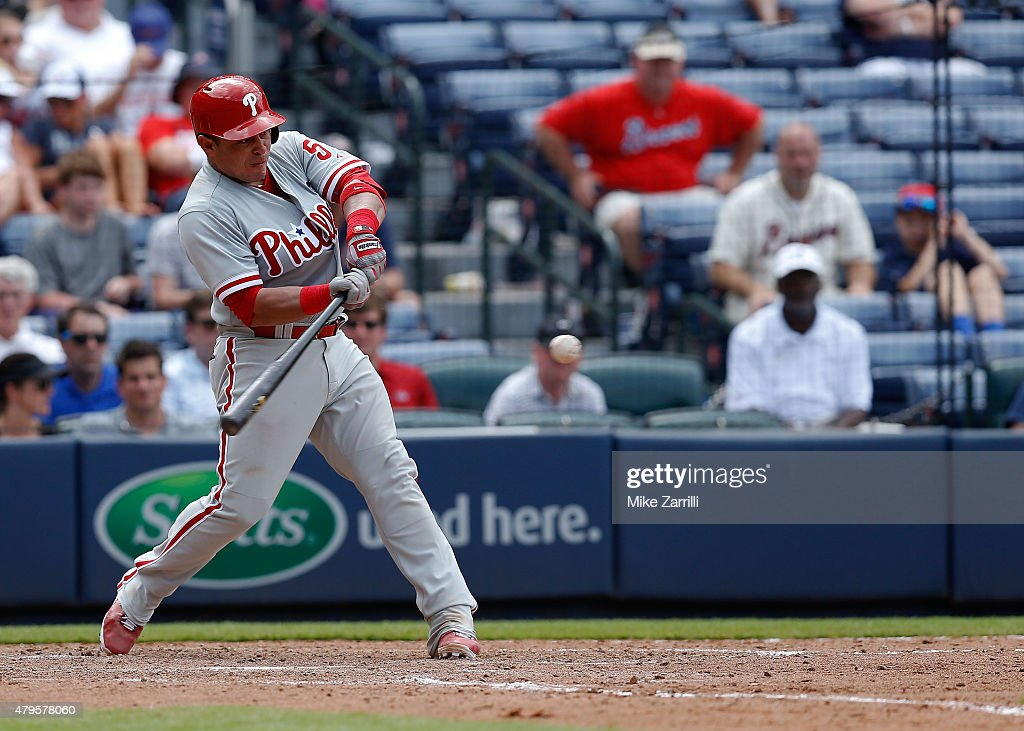 Catcher <a gi-track='captionPersonalityLinkClicked' href=/galleries/search?phrase=Carlos+Ruiz+-+Baseball+Player&family=editorial&specificpeople=216605 ng-click='$event.stopPropagation()'>Carlos Ruiz</a> #51 of the Philadelphia Phillies hits a two 2-run double in the tenth inning of the game against the Atlanta Braves at Turner Field on July 5, 2015 in Atlanta, Georgia.