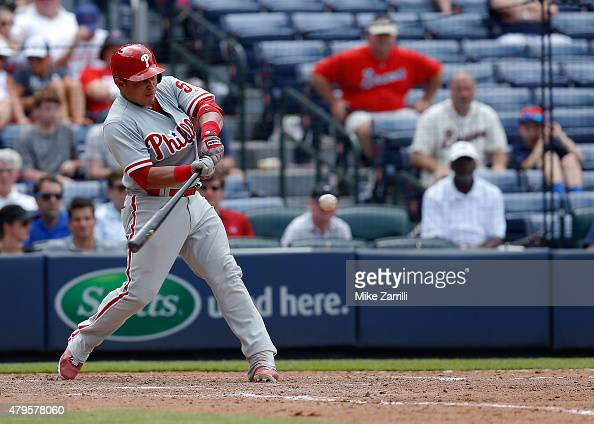Catcher Carlos Ruiz of the Philadelphia Phillies hits a two 2run double in the tenth inning of the game against the Atlanta Braves at Turner Field on...