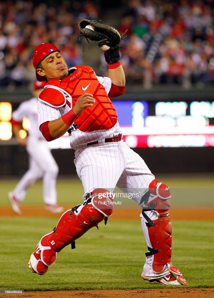 Catcher Carlos Ruiz #51 of the Philadelphia Phillies holds onto a pop up by Greg Dobbs #29 of the Miami Marlins during the ninth inning in a MLB baseball game on May 4, 2013 at Citizens Bank Park in Philadelphia, Pennsylvania. The Marlins defeated the Phillies 2-0.