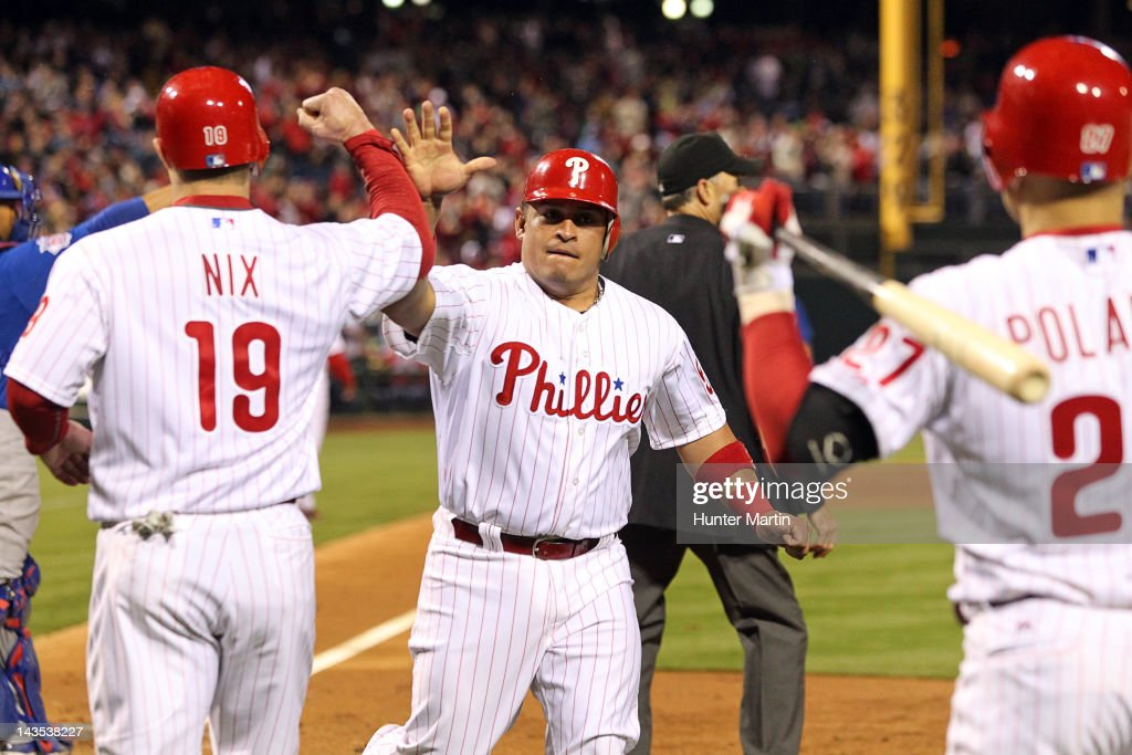 Catcher Carlos Ruiz #51 of the Philadelphia Phillies is congratulated by teammates after scoring a run during a game against the Chicago Cubs at Citizens Bank Park on April 28, 2012 in Philadelphia, Pennsylvania.
