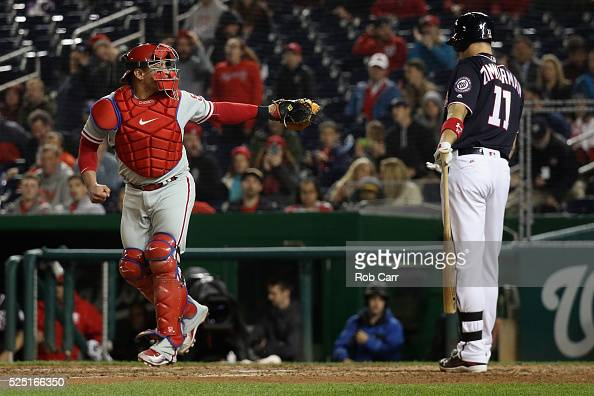 Catcher Carlos Ruiz of the Philadelphia Phillies looks back the umpire after Ryan Zimmerman of the Washington Nationals was called out looking for...