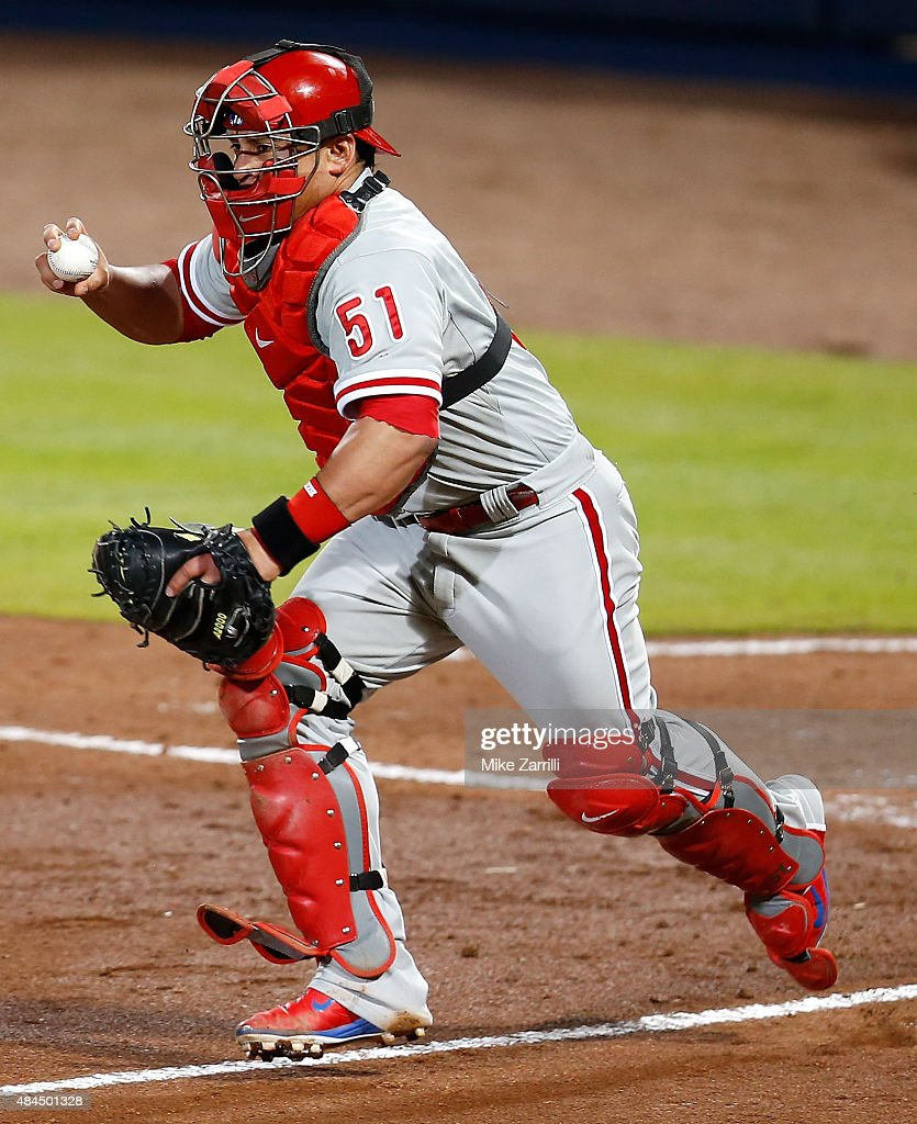 Catcher Carlos Ruiz of the Philadelphia Phillies looks to third base during a rundown during the game against the Atlanta Braves at Turner Field on...