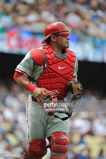Catcher Carlos Ruiz of the Philadelphia Phillies runs off the field against the Los Angeles Dodgers at Dodger Stadium on June 30 2013 in Los Angeles...