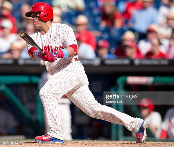 Catcher Carlos Ruiz of the Philadelphia Phillies swings the bat against the Chicago Cubs on June 15 2014 at Citizens Bank Park in Philadelphia...